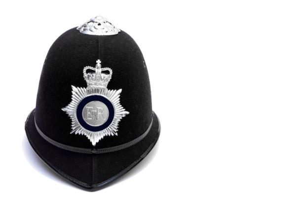 traditional british police custodian hemet on white