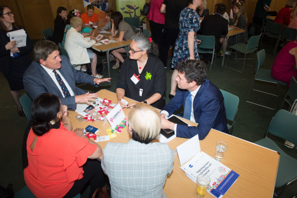 Kit Malthouse MP speaking with carer Bushra Tahir, Fiona Collie of Carers Scotland, Huw Merriman MP and Emily Holzhausen from Carers UK (from L)